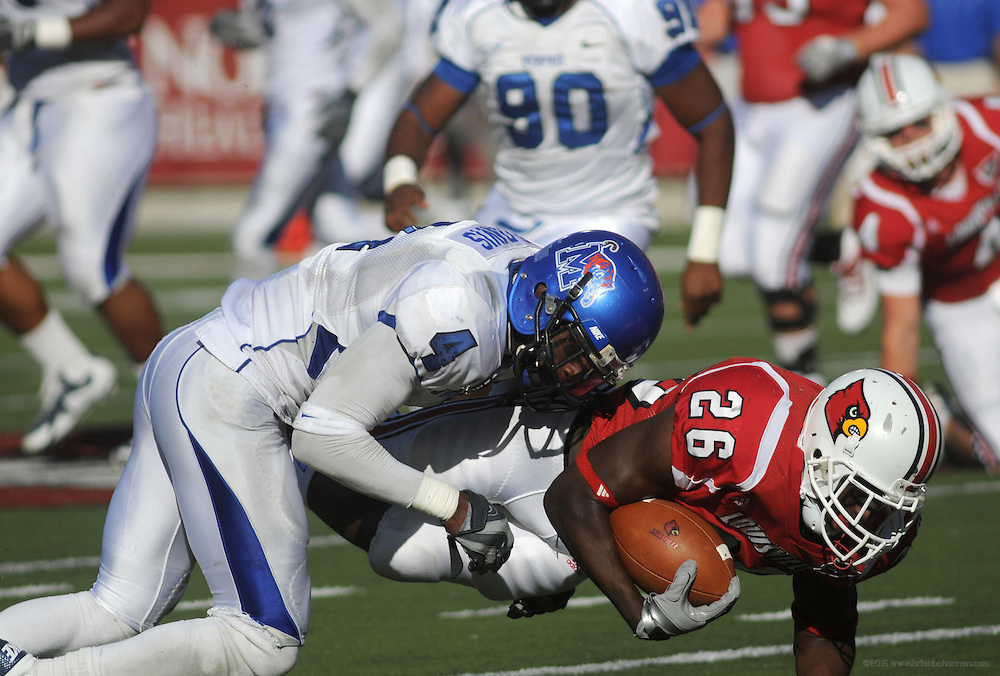 Memphis defensive back Darius Davis (4) tackles Louisville running back Zed Evans (26) during the second half of their NCAA college football game against Louisville Saturday, Oct. 9, 2010 at Cardinal Stadium in Louisville, Ky. Louisville won, 56 - 0. (AP Photo/Brian Bohannon)..