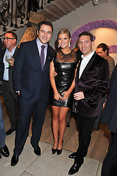 Left to right, DAVID WALLIAMS, HOLLY VALANCE and NICK CANDY at a reception to celebrate the publication of Candy and Candy: The Art of Design held at the Halcyon Gallery, 24 Bruton Street, London W1 on 26th October 2011.