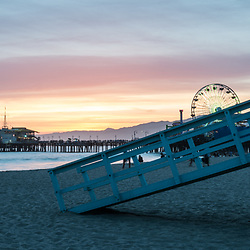 Santa Monica Pier and Lifeguard Tower 17 at sunset along the Pacific Ocean in Southern California. Panorama photo ratio is 1:3. Copyright ⓒ 2017 Paul Velgos with All Rights Reserved.
