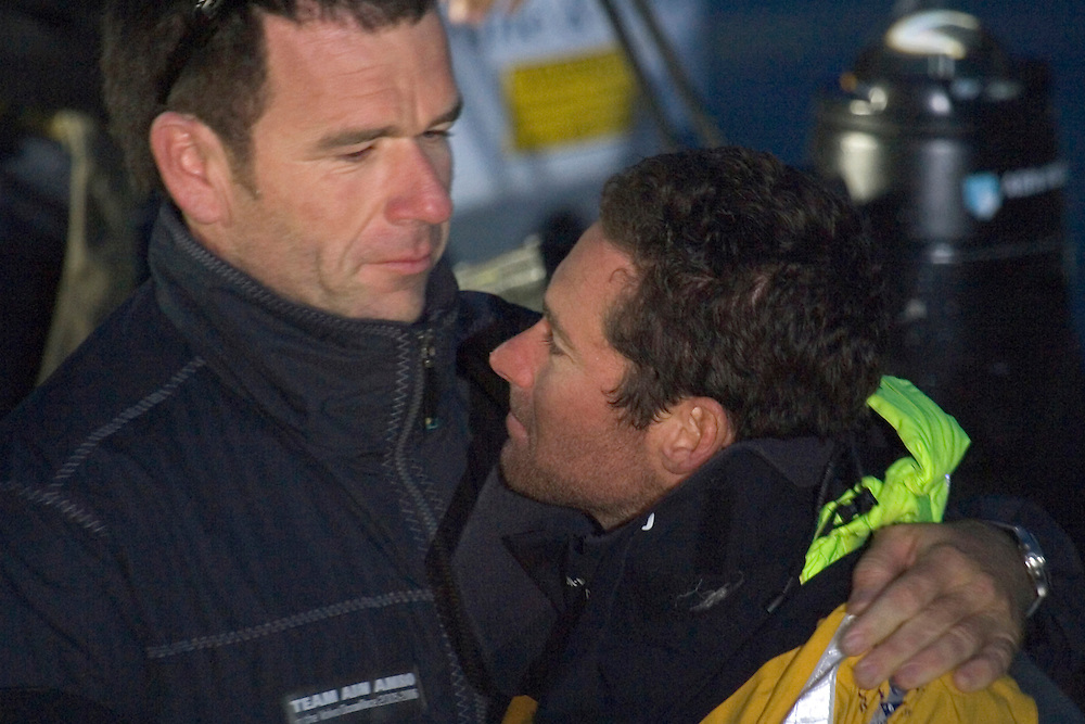 ABN Amro 2, skippered by Sebastien Josse (FR), arrive on the dock in Portsmouth after finishing Leg 7 of the Volvo Ocean Race 2005-6, 22nd May 2006..Seb Josse is greeted by Mike Sanderson (NZL), skipper of ABN Amro One