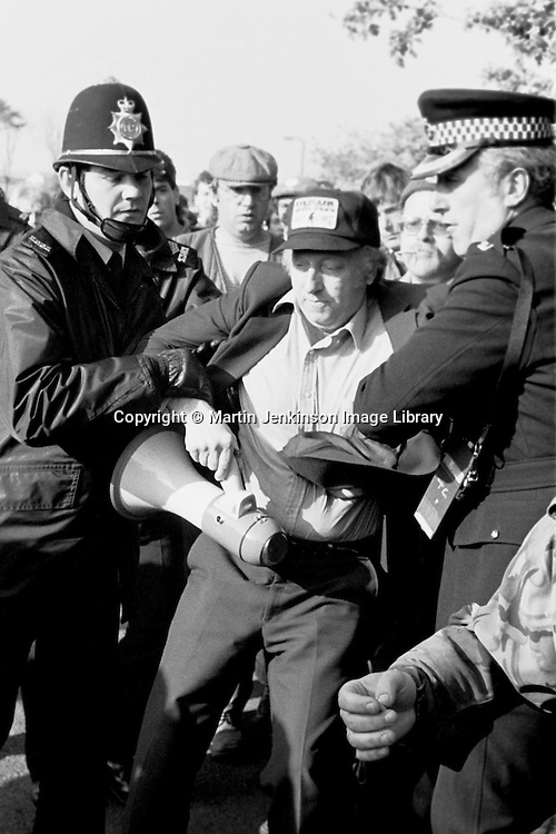 Superintendent John Nesbit arrests Arthur Scargill, NUM President at Orgreave during the 1984-85 miners strike 30 May 1984...© Martin Jenkinson  martin@pressphotos.co.uk  <br /> NUJ recommended terms & conditions apply. Copyright Designs & Patents Act 1988. Moral rights asserted credit required. No part of this photo to be stored, reproduced, manipulated or transmitted by any means without prior written permission.