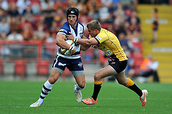 Matthew Morgan of Bristol Rugby is tackled - Photo mandatory by-line: Patrick Khachfe/JMP - Mobile: 07966 386802 21/09/2014 - SPORT - RUGBY UNION - Bristol - Ashton Gate - Bristol Rugby v Cornish Pirates - GK IPA Championship.