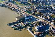 Nederland, Zuid-Holland, Sliedrecht, 07-02-2018; Rivierdijk met scheepswerf Baars, gespecialiseerd in baggermaterieel en pontons.<br /> Shipyard.<br /> <br /> luchtfoto (toeslag op standard tarieven);<br /> aerial photo (additional fee required);<br /> copyright foto/photo Siebe Swart