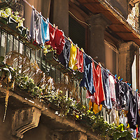 Italian building with balcony and hanging washing in Venice