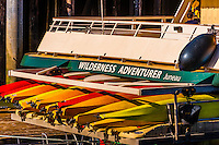 Kayaks on the stern of the Un-Cruise Adventures (small cruise ship) Wilderness Adventurer, docked in Juneau, Alaska USA.