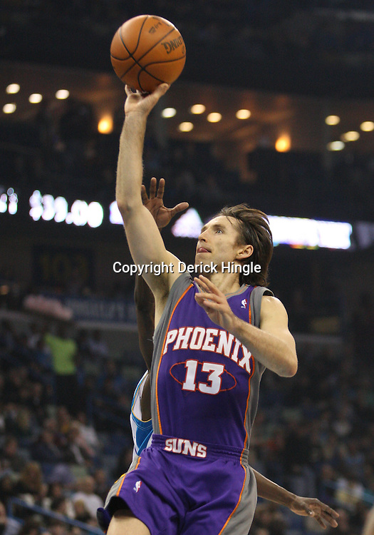 Feb 01, 2010; New Orleans, LA, USA; Phoenix Suns guard Steve Nash (13) shoots over New Orleans Hornets guard Darren Collison (rear) during the first half at the New Orleans Arena. Mandatory Credit: Derick E. Hingle-US PRESSWIRE