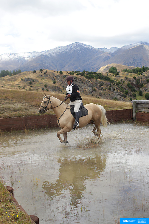 David Williamson riding Inca in action at the water jump during the Cross Country event at the Wakatipu One Day Horse Trials at the Pony Club grounds,  Queenstown, Otago, New Zealand. 15th January 2012. Photo Tim Clayton