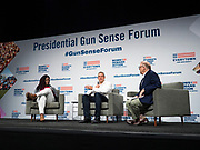 10 AUGUST 2019 - DES MOINES, IOWA: DEANDRA YATES DYCUS, Everytown Survivor Fellow, (left), Congressman TIM RYAN (D-OH), a Democratic Presidential candidate, and JOHN FEINBLATT, President of Every Town for Gun Safety, talk about gun safety legislation at the Presidential Gun Sense Forum. Several thousand people from as far away as Milwaukee, WI, and Chicago, came to Des Moines Saturday for the Presidential Gun Sense Forum. Most of the Democratic candidates for president attended the event, which was organized by Moms Demand Action, Every Town for Gun Safety, and Students Demand Action.      PHOTO BY JACK KURTZ