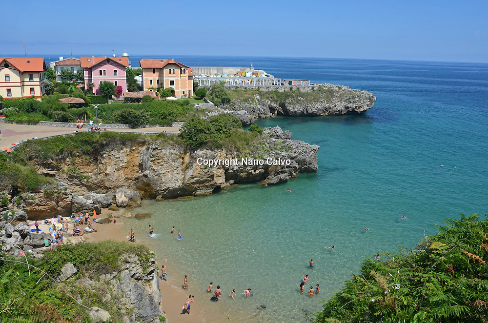Summer day on a beach in Llanes, Asturias, Spain