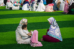 February 14, 2013 - Central Jakarta, Jakarta, Indonesia - Muslim womens during Eid Al-Fitr prayer on plastic grass at futsal stadium on June 15, 2018 in Jakarta, Indonesia. Muslims around the world are celebrating Eid al-Fitr, the three day festival marking the end of the Muslim holy month of Ramadan, it will be observed on 15th or 16th of June depending on the lunar calendar. Eid al-Fitr is one of the two major holidays in Islam. (Credit Image: © Afriadi Hikmal via ZUMA Wire)