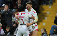 Tommy Makinson of England celebrates  scoring his 2nd try of the game  with team mate Jonny Lomax against New Zealand during the Autumn International Series match at Anfield, Liverpool<br /> Picture by Stephen Gaunt/Focus Images Ltd +447904 833202<br /> 04/11/2018