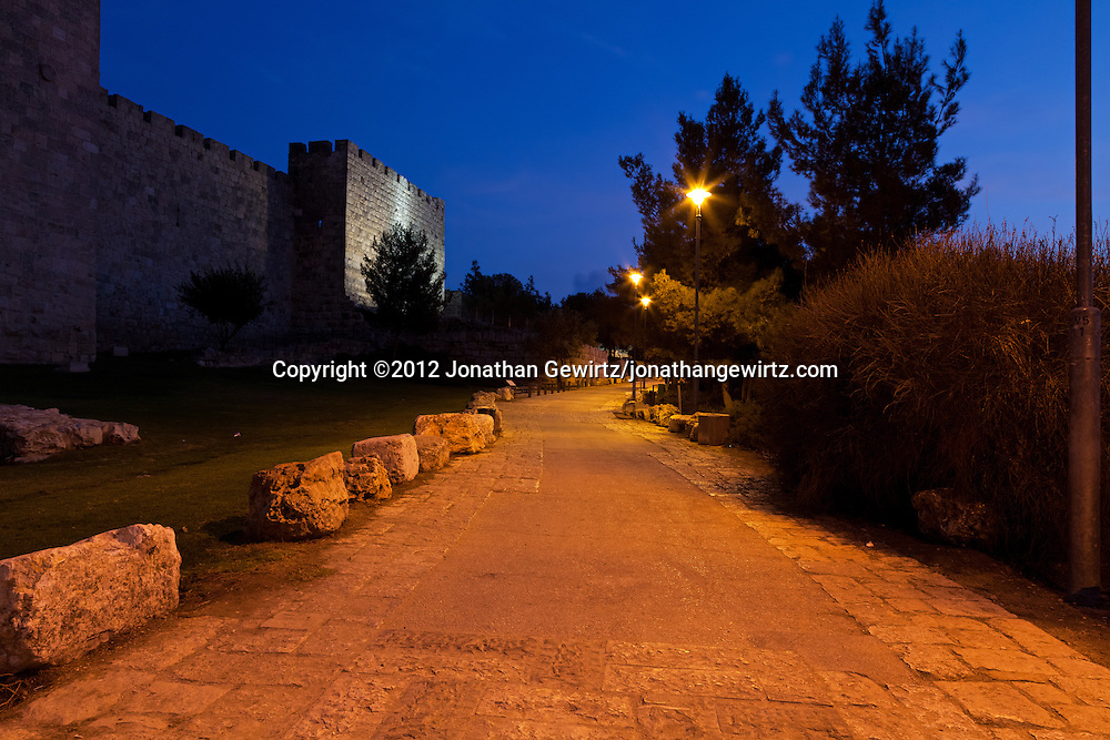 Night view, facing in the direction of Mount Zion, of a walking path just outside of the walls of the Old City of Jerusalem. WATERMARKS WILL NOT APPEAR ON PRINTS OR LICENSED IMAGES.