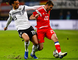 November 15, 2018 - Leipzig, Germany - Leroy Sane (L) of Germany and Aleksey Ionov of Russia vie for the ball during the international friendly match between Germany and Russia on November 15, 2018 at Red Bull Arena in Leipzig, Germany. (Credit Image: © Mike Kireev/NurPhoto via ZUMA Press)