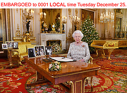 EMBARGOED to 0001 LOCAL time Tuesday December 25. Queen Elizabeth II after she recorded her annual Christmas Day message, in the White Drawing Room of Buckingham Palace in central London.