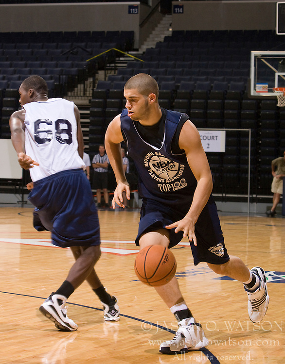 C/F Bobby Capobianco (Loveland, OH / Loveland) dribbles past PF Rakeem Buckles (Opa Locka, FL / Monsignor Edward Pace).  The NBA Player's Association held their annual Top 100 basketball camp at the John Paul Jones Arena on the Grounds of the University of Virginia in Charlottesville, VA on June 19, 2008