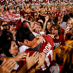 November 3, 2012; Baton Rouge, LA, USA; Alabama Crimson Tide quarterback AJ McCarron (10) celebrates with fans in the stands following a win over the LSU Tigers in a game at Tiger Stadium. Alabama defeated LSU 21-17. Mandatory Credit: Derick E. Hingle-USA TODAY SPORTS