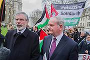 Gerry Adams and Martin McGuiness. Tony Benn's funeral at 11.00am at St Margaret's Church, Westminster. His body was brought in a hearse from the main gates of New Palace Yard at 10.45am, and was followed by members of his family on foot. The rout was lined by admirers. On arrival at the gates it was carried into the church by members of the family. Thursday 27th March 2014, London, UK. Guy Bell, 07771 786236, guy@gbphotos.com