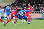 Crawley Town Defender Jon Ashton (16) challenges Bayo Akinfenwa forward for AFC Wimbledon (10) during the Sky Bet League 2 match between AFC Wimbledon and Crawley Town at the Cherry Red Records Stadium, Kingston, England on 16 April 2016. Photo by Stuart Butcher.