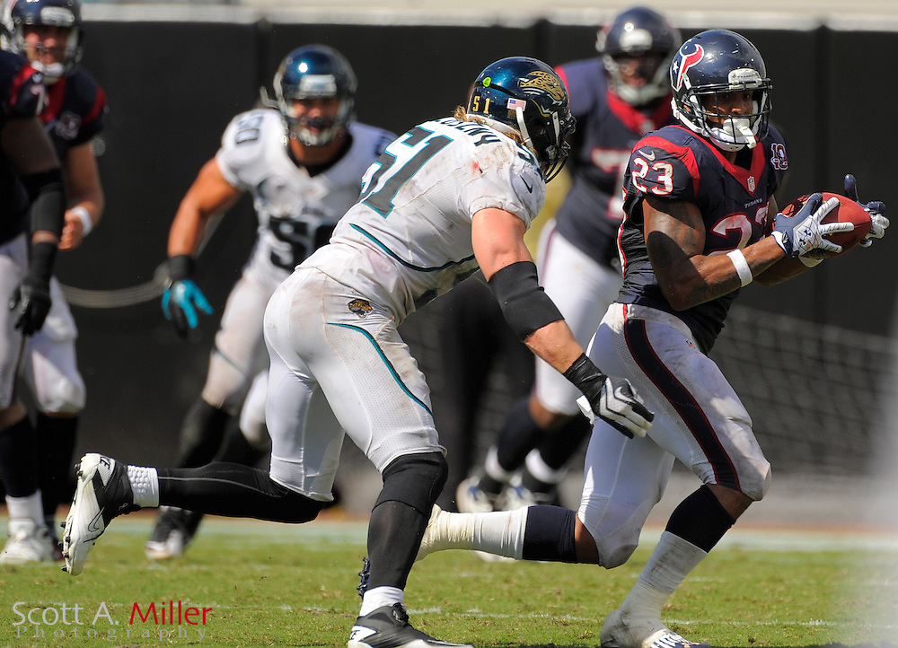 Houston Texans running back Arian Foster (23) is chased by Jacksonville Jaguars middle linebacker Paul Posluszny (51) as he runs upfield during the Texans 27-7 win at EverBank Field on September 16, 2012 in Jacksonville, Florida. ..©2012 Scott A. Miller..