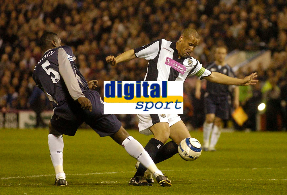 Photo: Glyn Thomas.<br />West Bromwich Albion v Bolton Wanderers. The Barclays Premiership. 17/04/2006.<br /> West Brom's Nigel Quashie (R) sends in a shot despite the attentions of Bolton's Bruno N'Gotty.