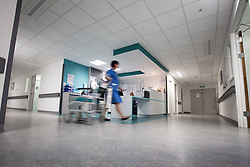 © Licensed to London News Pictures . FILE PICTURE DATED 12/05/2013 .  Salford Royal Hospital , Greater Manchester , UK . A nurse working on a ward in Salford Royal Hospital today (Sunday 12th May) as senior nurses have issued a warning about nurse:patient ratios in England . Photo credit : Joel Goodman/LNP