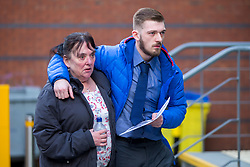 """© Licensed to London News Pictures. 01/02/2018. Liverpool UK. Tom Evans father of Alfie Evans arrives at Liverpool Civil & Family Court this morning with his mother. Tom Evans and Kate James from Liverpool are in dispute with medics looking after their son 19-month-old son Alfie Evans, at Alder Hey Children's Hospital in Liverpool. Alfie is in a """"semi-vegetative state"""" and had a degenerative neurological condition doctors have not definitively diagnosed. Specialists at Alder Hey say continuing life-support treatment is not in Alfie's best interests but the boy's parents want permission to fly their son to a hospital in Rome for possible diagnosis and treatment.Photo credit: London News Pictures"""