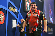 Mensur Suljovic celebrates winning the sixth set during his second round match with Mark Webster during the William Hill World Darts Championship at Alexandra Palace, London, United Kingdom on 27 December 2016. Photo by Shane Healey.