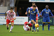 George Francomb of AFC Wimbledon breaks away during the Sky Bet League 2 match between AFC Wimbledon and Stevenage at the Cherry Red Records Stadium, Kingston, England on 12 December 2015. Photo by Stuart Butcher.