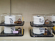 """04 APRIL 2020 - DES MOINES, IOWA: Cakes baked in the shape of toilet paper in the toilet paper section of a Des Moines grocery store, which is out of real toilet paper. On Saturday morning, 04 April, Iowa reported 786 confirmed cases of the Novel Coronavirus (SARS-CoV-2) and COVID-19. There have been 14 deaths attributed to COVID-19 in Iowa. Restaurants, bars, movie theaters, places that draw crowds are closed until 30 April. The Governor has not ordered """"shelter in place"""" but several Mayors, including the Mayor of Des Moines, have asked residents to stay in their homes for all but the essential needs. People are being encouraged to practice """"social distancing"""" and many businesses are requiring or encouraging employees to telecommute.        PHOTO BY JACK KURTZ"""
