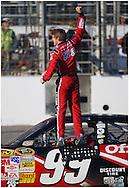 HAMPTON, GA:,Carl Edwards does a backflip  after winning the Pep Boys Auto 500 at Atlanta Motor Speedway on Sunday10/26/08, ©2008 Johnny Crawford