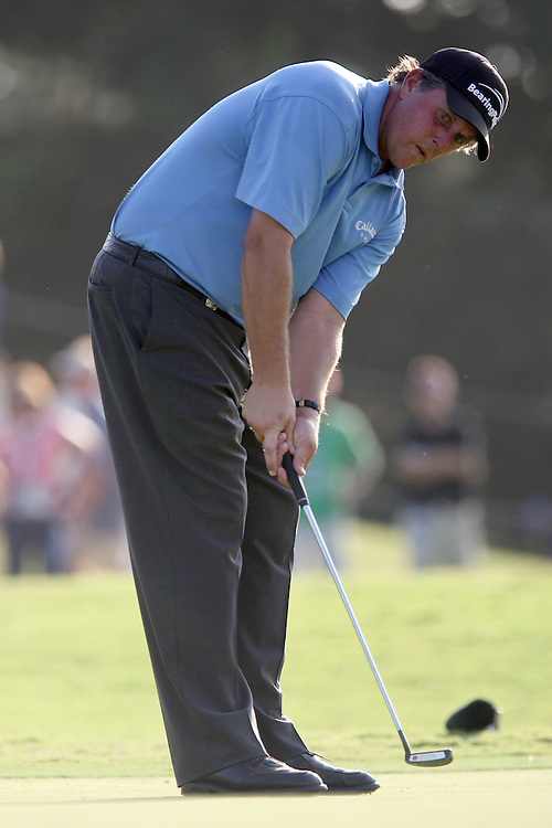 09 August 2007: Phil Mickelson putts on the 18th green during the first round of the 89th PGA Championship at Southern Hills Country Club in Tulsa, OK.