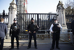 © Licensed to London News Pictures. 11/12/2018. London, UK. Police stand guard outside The Carriage Gate entrance to Parliament after an intruder was arrested. Prime Minister Theresa May is touring European countries today in a bid to obtain changes to the Brexit withdrawal agreement. Photo credit: Peter Macdiarmid/LNP