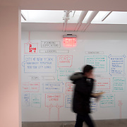 March 4, 2015 - New York, NY : A man walks through a hallway, past a white board listing the incubator's supporters and founders, at New Inc., on Wednesday, March 4. New Inc. is a museum-led art, technology, and design incubator conceived by the New Museum in 2013 and launched in September 2014 in a space next to the museum, on the Bowery in Manhattan.  CREDIT: Karsten Moran for The New York Times