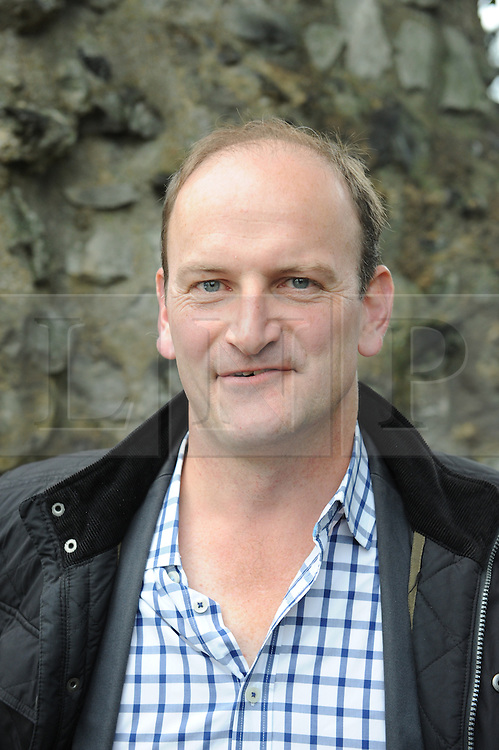 © Licensed to London News Pictures. 11/10/2014<br /> UKIP MP Douglas Carswell arriving at the back door to the Rochester UKIP shop.<br /> Press outside Mark Reckless UKIP shop 30 Rochester High Street. 8.30 am.<br /> UKIP Leader Nigel Farage on a walk about in Rochester today (11.10.2014)with Mark Reckless and new UKIP MP for Clacton Carswell.<br /> (Byline:Grant Falvey/LNP)