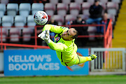 Morecambe goalkeeper Barry Roche makes a flying save during the Sky Bet League 2 match between Exeter City and Morecambe at St James' Park, Exeter, England on 30 April 2016. Photo by Graham Hunt.
