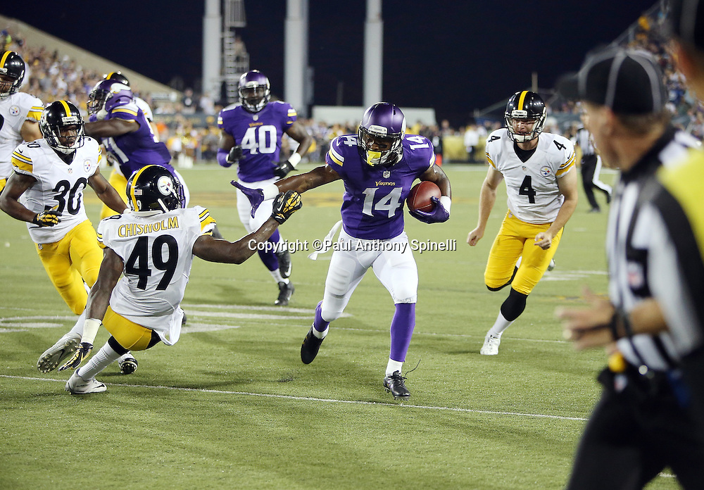 Minnesota Vikings wide receiver Stefon Diggs (14) dodges a tackle attempt by Pittsburgh Steelers linebacker Shayon Green (49) as he returns a punt 62 yards to the one yard line setting up a touchdown during the 2015 NFL Pro Football Hall of Fame preseason football game against the Pittsburgh Steelers on Sunday, Aug. 9, 2015 in Canton, Ohio. The Vikings won the game 14-3. (©Paul Anthony Spinelli)