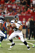 ATLANTA, GA - JANUARY 13: Russell Wilson #3 of the Seattle Seahawks looks to pass the ball against the Atlanta Falcons during the NFC Divisional Playoff Game at Georgia Dome on January 13, 2013 in Atlanta, Georgia. The Falcons defeated the Seahawks 30-28. (Photo by Joe Robbins) *** Local Caption *** Russell Wilson