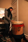 Kearny, New Jersey. November 19, 2013. Yadira Aleman with the drum used for ceremonial dances, kept in her hallway in Kearny. Photo by Maya Rajamani/NYCity Photo Wire
