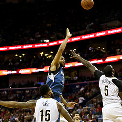 Feb 27, 2016; New Orleans, LA, USA; Minnesota Timberwolves center Karl-Anthony Towns (32) shoots over New Orleans Pelicans center Kendrick Perkins (5) during the first half of a game at  the Smoothie King Center. Mandatory Credit: Derick E. Hingle-USA TODAY Sports