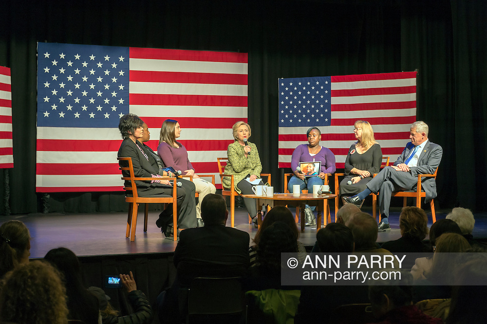 Port Washington, New York, USA. April 11, 2016. HILLARY CLINTON, Democratic presidential primary candidate, has a discussion on gun violence prevention with Rep. STEVE ISRAEL and activists who lost family members due to shootings: (L-R) RITA KESTENBAUM who lost her daughter Carol at Arizona State University; MARIE DELUS who lost her nephew Pierre-Paul Jean-Paul in Queens; ERICA SMEGIELSKI who lost her mother Dawn Lafferty Hochsprungand the Sandy Hook Elementary School Principal in Newtown CT; NATASHA CHRISTOPHER who lost her 15-year-old son Akeal in Brooklyn; and SANDY PHILLIPS who lost her daughter Jessica Ghawi in Aurora, Colorado theater shooting.