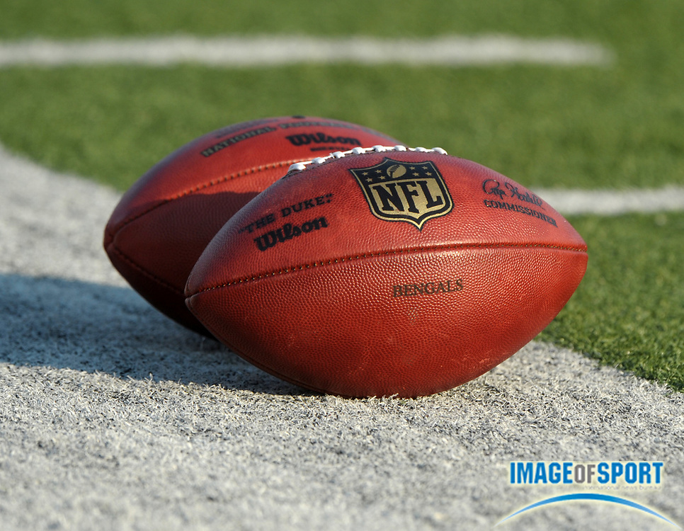 Aug 8, 2010; Canton, OH, USA; General view of Wilson NFL footballs on the sidelines during the preseason game between the Dallas Cowboys and the Cincinnati Bengals at Fawcett Stadium. Photo by Image of Sport