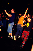Punks dancing at a gig. Astoria 2. London 2000