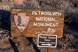 National Park Service welcome sign and directions to the visitor center, Petroglyph National Monument, Albuquerque, New Mexico, United States of America