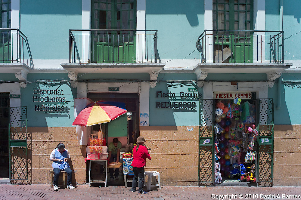 Building with shops, women selling things, Quito, Ecuador