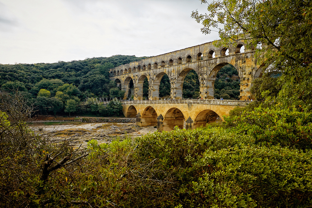 View of Pont du Gard (Roman Aqueduct), the second highest standing Roman structure, and built in 19 BC above the Gardon River, Vers-Pont-du-Gard, France.