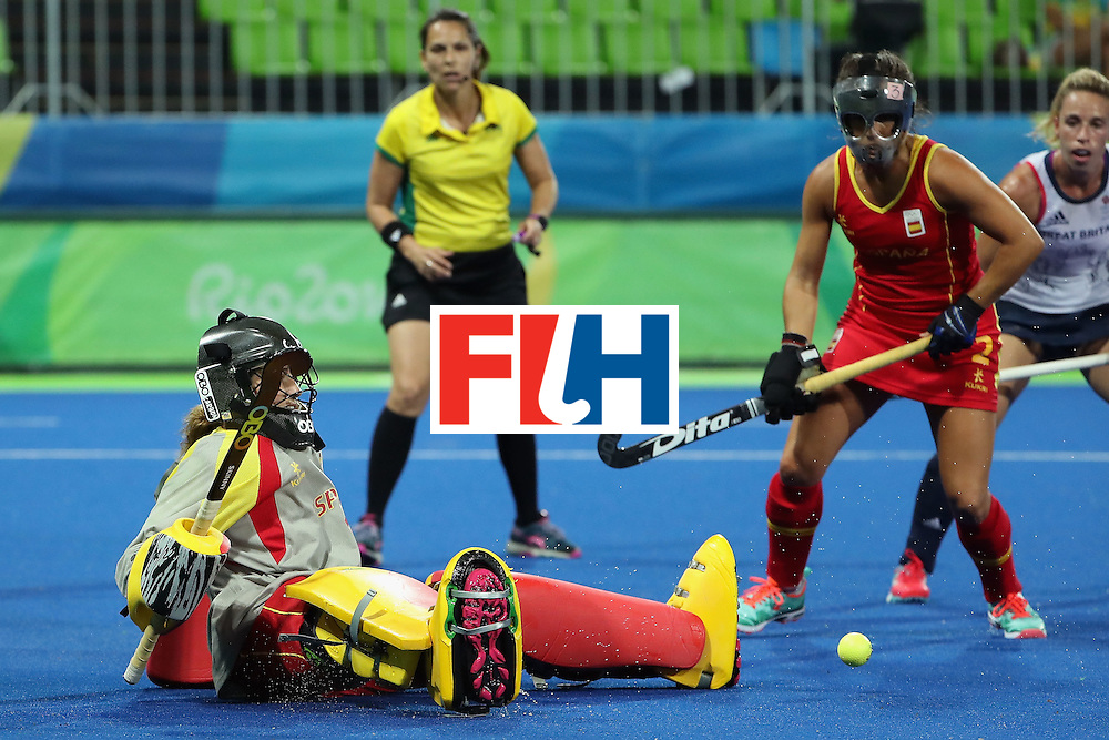 RIO DE JANEIRO, BRAZIL - AUGUST 15:  Goalkeeper Maria Lopez de Eguilaz #1 of Spain makes a save against Great Britain during the quarter final hockey game on Day 10 of the Rio 2016 Olympic Games at the Olympic Hockey Centre on August 15, 2016 in Rio de Janeiro, Brazil.  (Photo by Christian Petersen/Getty Images)