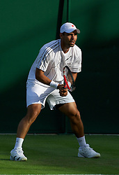 LONDON, ENGLAND - Tuesday, June 21, 2011: Alejandro Falla (COL) in action during the Gentlemen's Singles 1st Round match day two of the Wimbledon Lawn Tennis Championships at the All England Lawn Tennis and Croquet Club. (Pic by David Rawcliffe/Propaganda)