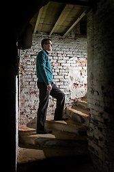 © Licensed to London News Pictures. 23/06/2015. Leeds, UK. Rarely seen hidden Tudor tunnels & cellars of Temple Newsam house in Yorkshire. Picture shows a member of staff standing on a hidden stairwell underneath the house. Temple Newsam is famous as the birth place of Lord Darnley, notorious husband of Mary Queen of Scots. The Tudor-Jacobean mansion is set in 1,500 acres with grounds landscaped by Capability Brown. Photo credit : Andrew McCaren/LNP