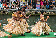 "A dance of Fiji in the Canoe Pageant, ""Rainbows of Paradise."" The Polynesian Cultural Center (PCC) is a major theme park and living museum, in Laie on the northeast coast (Windward Side) of the island of Oahu, Hawaii, USA. The PCC first opened in 1963 as a way for students at the adjacent Church College of Hawaii (now Brigham Young University Hawaii) to earn money for their education and as a means to preserve and portray the cultures of the people of Polynesia. Performers demonstrate Polynesian arts and crafts within simulated tropical villages, covering Hawaii, Aotearoa (New Zealand), Fiji, Samoa, Tahiti, Tonga and the Marquesas Islands. The Rapa Nui (Easter Island) exhibit features seven hand-carved moai (stone statues). The PCC is run by the Church of Jesus Christ of Latter-day Saints (LDS Church). For this photo's licensing options, please inquire."