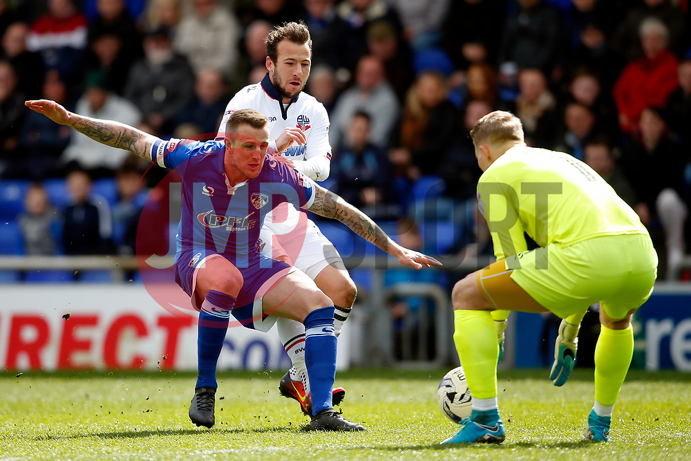 Peter Clarke of Oldham Athletic holds off Adam Le Fondre of Bolton Wanderers - Mandatory by-line: Matt McNulty/JMP - 15/04/2017 - FOOTBALL - Boundary Park - Oldham, England - Oldham Athletic v Bolton Wanderers - Sky Bet League 1
